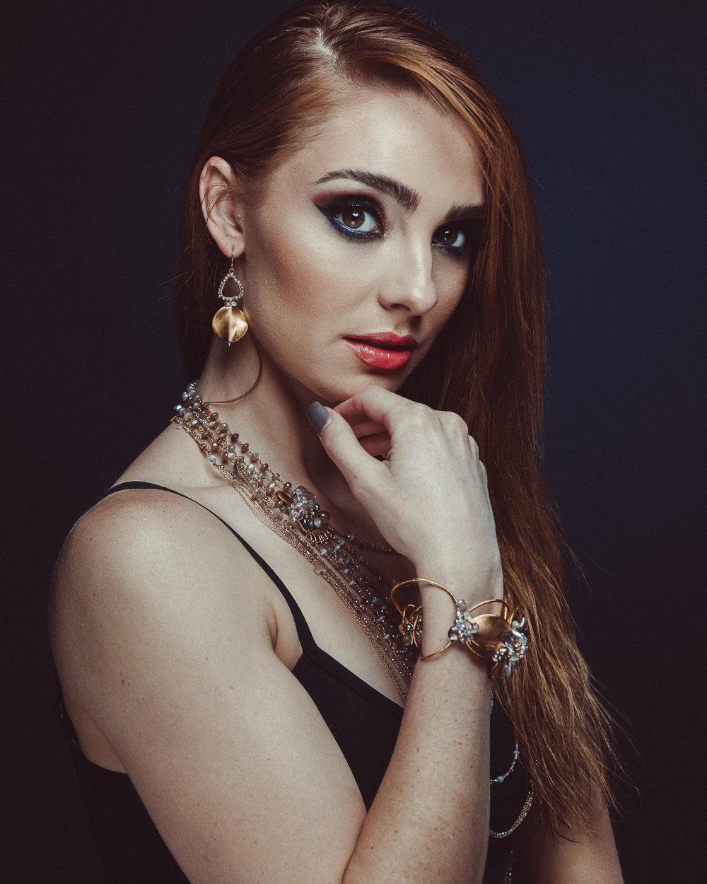 woman wearing gemstone statement cuff