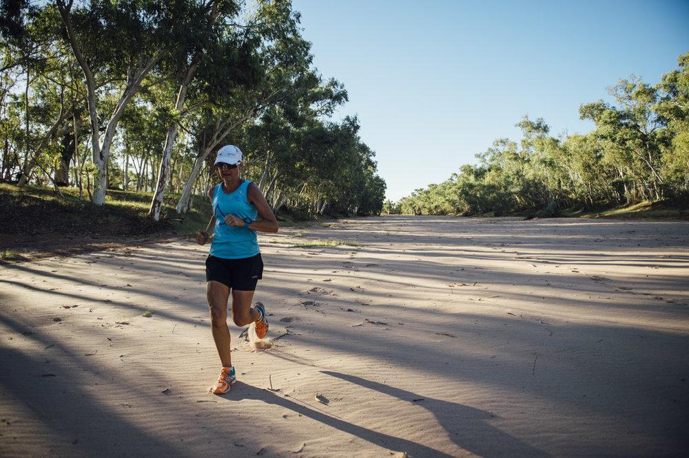Mina Guli Running Down a Dry Riverbed in Australia