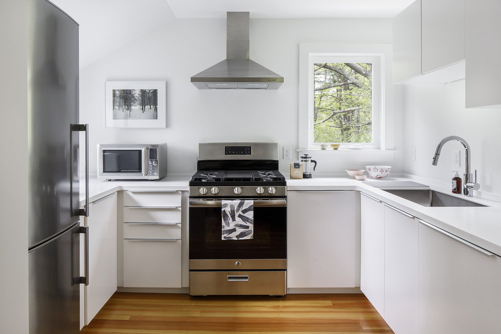 the Cook's Kitchen - The kitchen includes a full-size refrigerator, range, dishwasher, and microwave with basic dinnerware and cookware.
