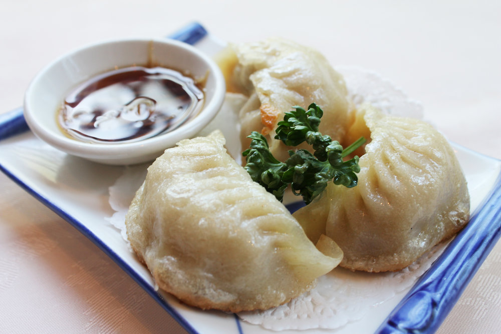 香煎锅贴饺  Grilled Pork Dumplings  £3.20
