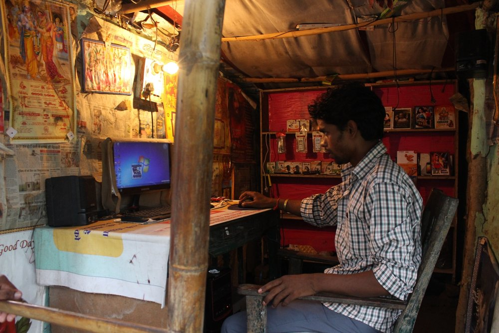 Young man operates a personal computer at his newly-inaugurated kiosk, Araria, 11 June 2016