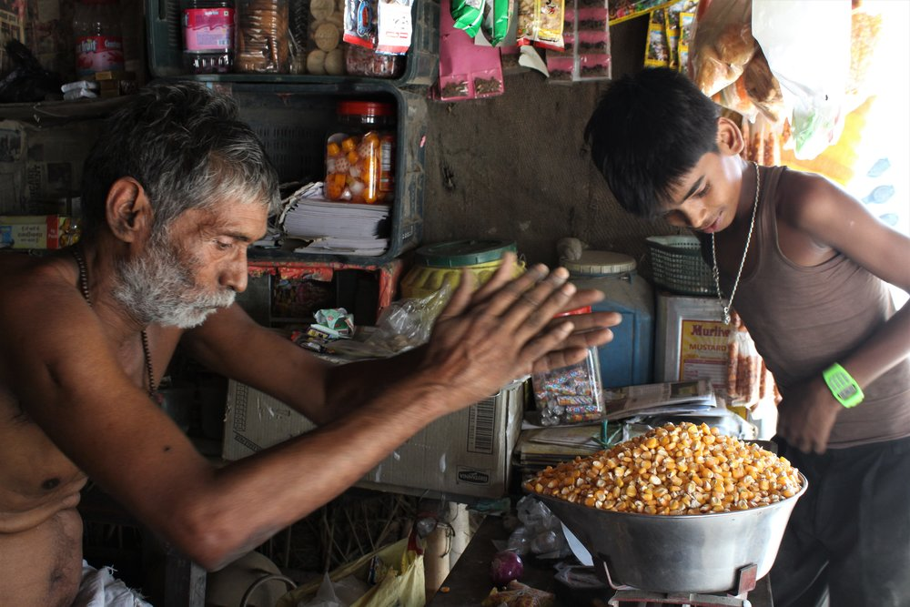 A man in a village in Araria sells maize grains at his shop. Credit: Atul Anand