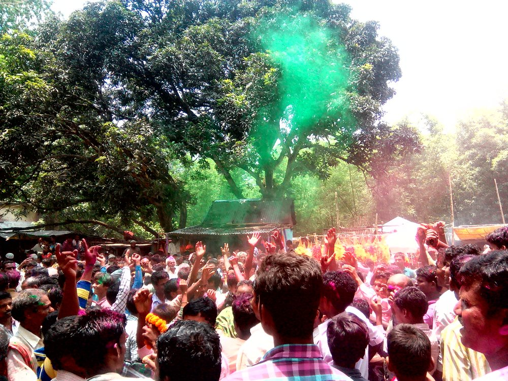 Villagers celebrate the victory of their village head candidate with gulal after the counting of votes. Credit: Zaheeb Ajmal
