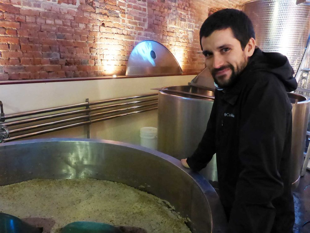 Chris checking the mash at Redlands Distillery School