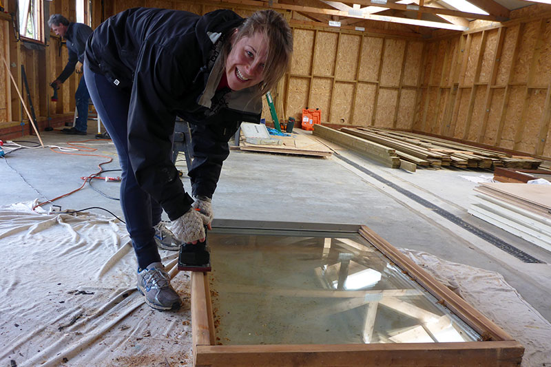 Abbie getting to work on the reclaimed timber windows