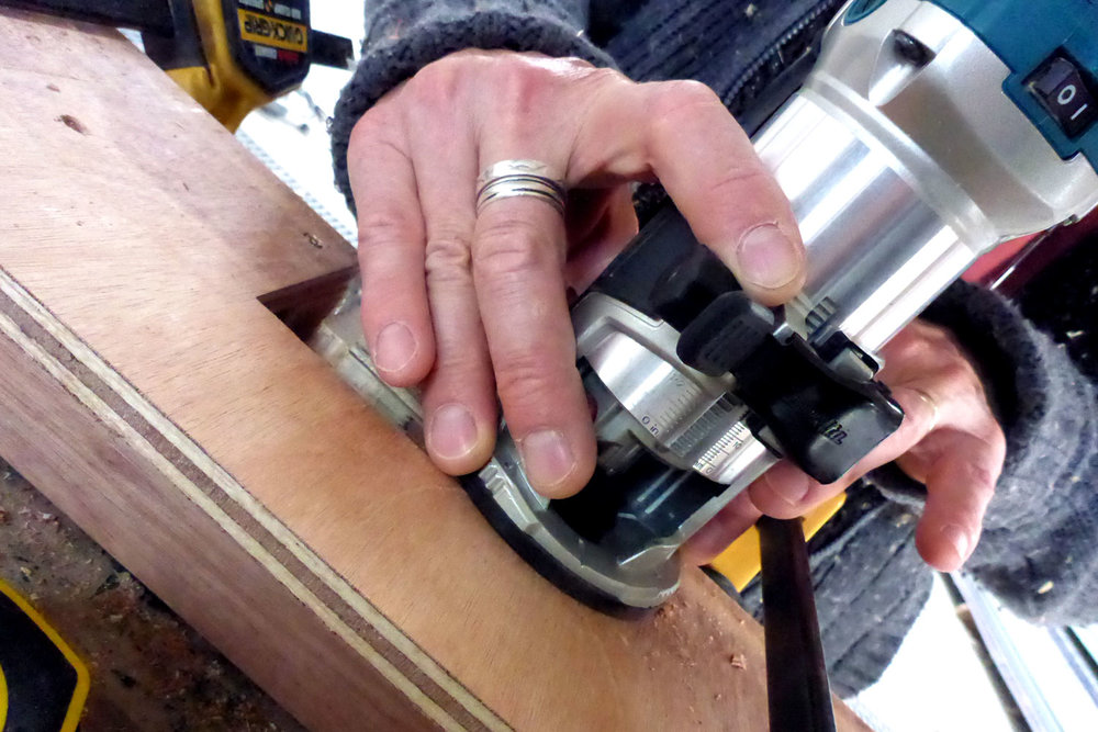 Routing out jigs for the Bond Store fire-door hinges.