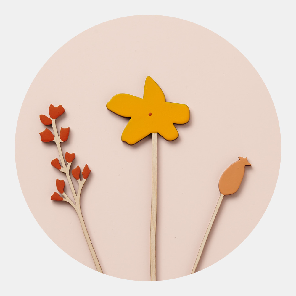 Hedgerow Set - Inspired by the pretty hedgerow flowers and berries of the English countryside, this set of three wooden flower stems – Flora, Rosehip and Mustard Flower – reflect the changing shades of Autumn.