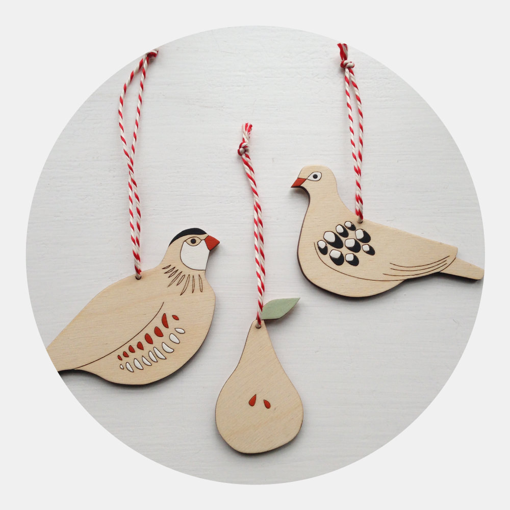 NEW! Twelve Days of Christmas - Inspired by the song the 'Twelve Days of Christmas'. Bold colours are set against light wood and finished with red and white twine for a wonderful festive feel. Partridge, Pear and Turtle Dove come individually or as a set.