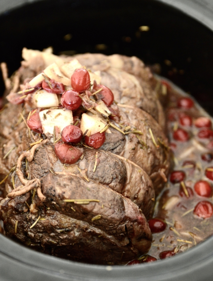 This Paleo Slow Cooker Cranberry Maple Beef Roast is going to become a new favourite recipe in your home. Bursting with flavour, and so easy to make this Paleo Slow Cooker Cranberry Maple Beef Roast turns out so tender because it is made in the slow cooker. This Paleo Slow Cooker Cranberry Maple Beef Roast doesn't require any fancy ingredients or cooking skills which makes it a great choice for those busy weeknight dinners. #paleo #slowcooker #cranberry