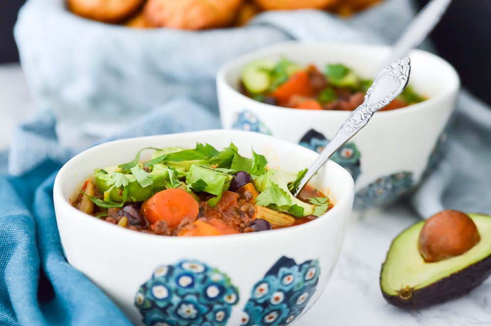 Whole30 Slow Cooker Chili with Blueberries is going to become your new favourite dinner. Not only is this Whole30 Slow Cooker Chili with Blueberries packed with flavour, it's also loaded with vegetables so it is so, so healthy. Because it's made in the slow cooker this Whole30 Slow Cooker Chili with Blueberries is also really easy to make. Your whole family is going to love it.  #whole30 #paleo #chili