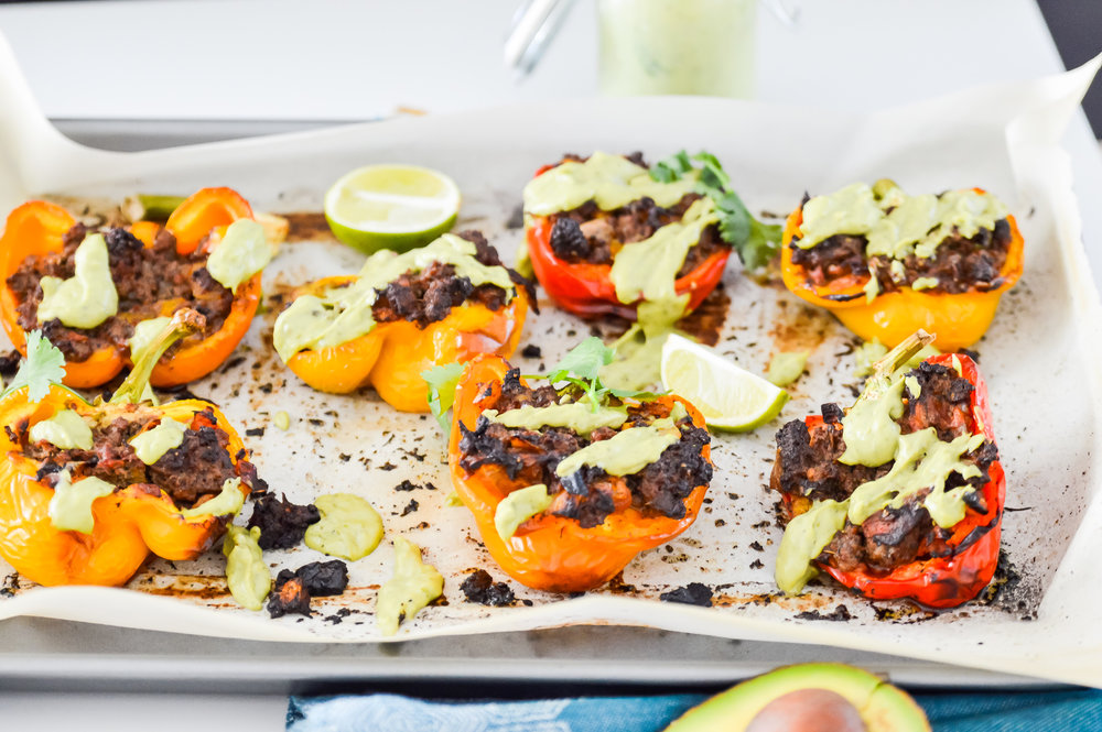 Whole30 Stuffed Peppers with Avocado Crème will be going on your meal plan this week. These Whole30 Stuffed Peppers with Avocado Crème make the perfect dinner solution and your whole family is going to love these Whole30 Stuffed Peppers with Avocado Crème. Whole30 Stuffed Peppers with Avocado Crème also make a great lunch or appetizer options.  #whole30 #paleo #gaps