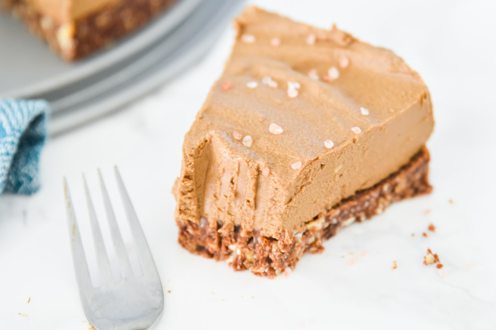 This Chocolate Avocado Torte are what dessert dreams are made of. This Chocolate Avocado Torte is the perfect combination of a slightly sweet crunchy crust with a melt in your mouth chocolate mousse topping. Serve this Chocolate Avocado Torte at your next dinner gathering and your guests will love you. #cake #vegan #chocolate #paleo