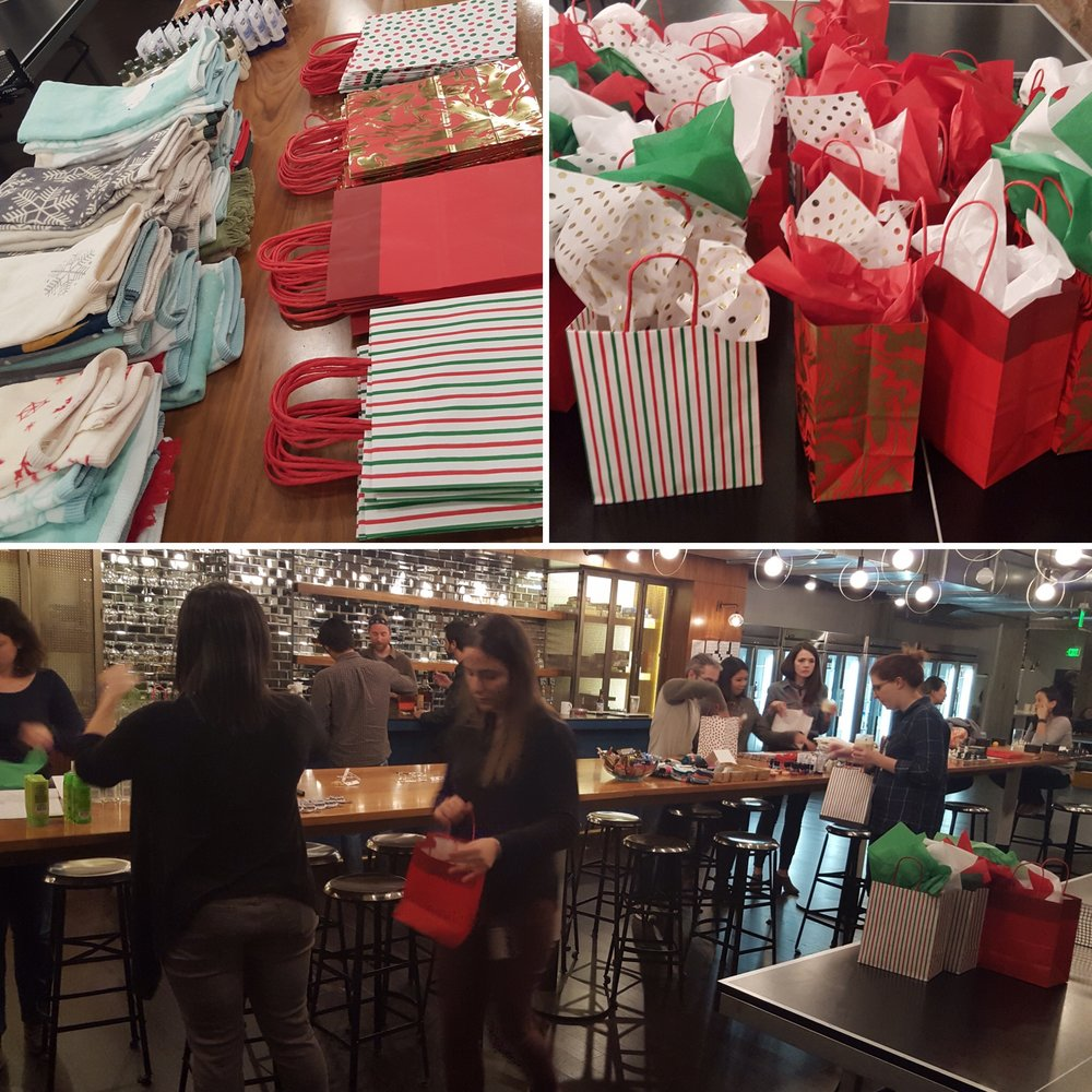 Lumosity employees assembling holiday gift bags as part of a CSR program.