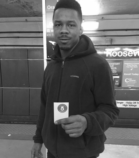 A helping hand; after a woman slipped and fell on the CTA platform in Chicago, this young man stopped to help her up and ask if she was okay.