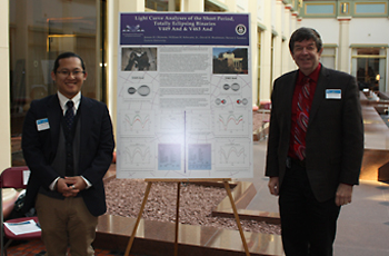 Pictured: Jensen Okimoto, left, and Dr. David Bradstreet, right, stand in front of their poster at the Undergraduate Research at the Capital - Pennsylvania 2016 poster conference.