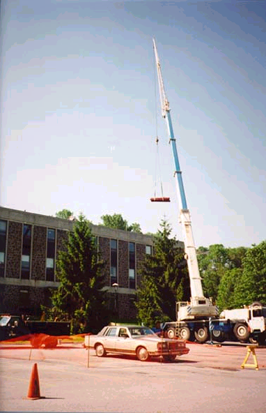 285 foot crane lifting I-beams