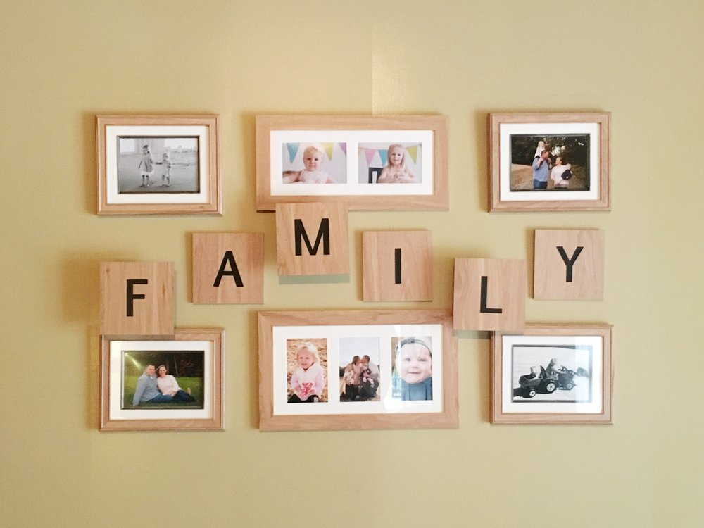 Our wall gallery with most photos by  Rachel Mummert Photography  and  Leah Adkins Photography .