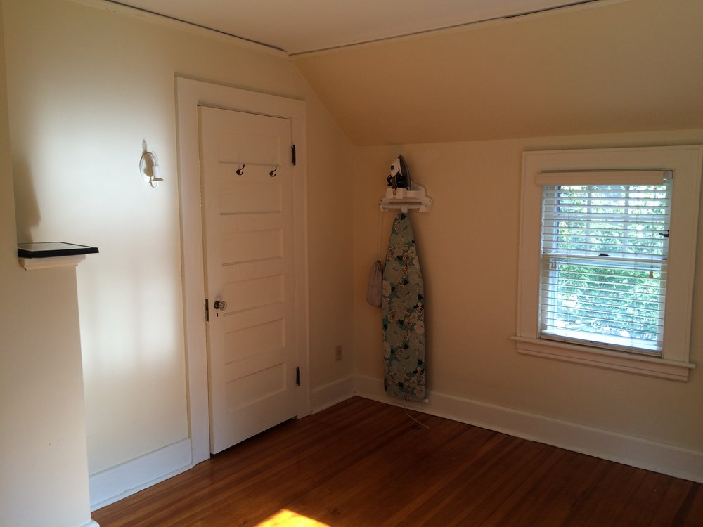 This is the main door which leads to the Master bedroom. Note the weird cutout and the slanted ceilings.