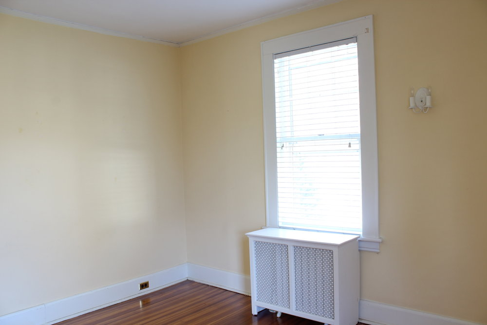 The space is pretty bland as is. The walls will be completely re-done and wallpapered over. In addition, we'll clean up the trim work and add in some new window treatments. That sweet little sconce will be staying, but will get a mini makeover too.