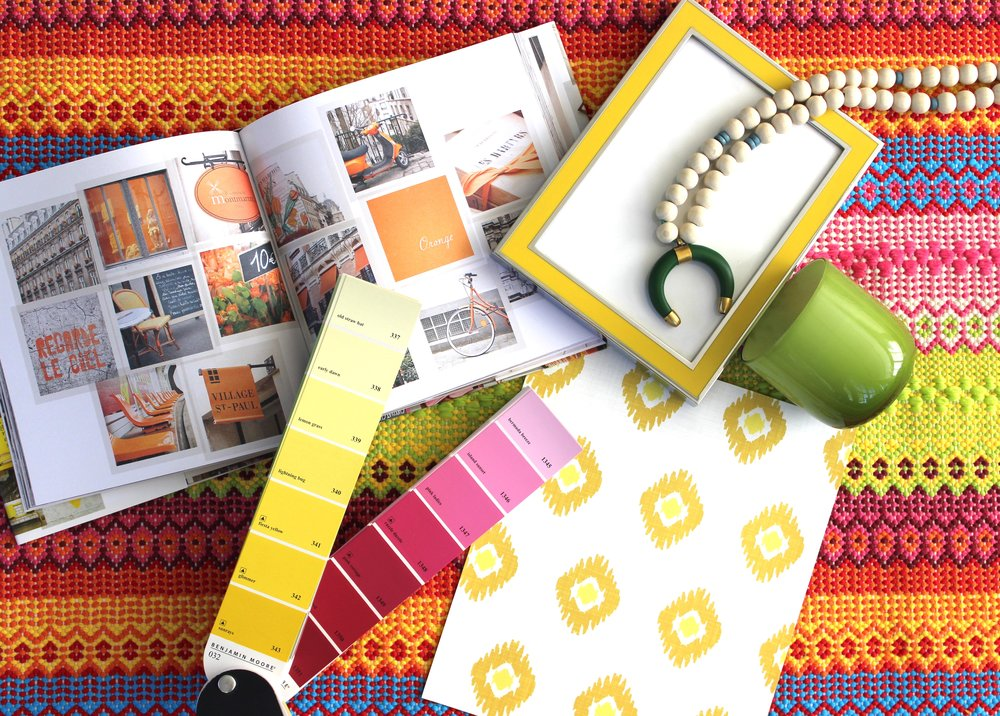 Our colorful vision board! Yellow ikat wallpaper and a hand woven rug will be our jumping off points for this space. While the entire room will have a rainbow effect, we're focusing on the warmer tones with lots of oranges and yellows.