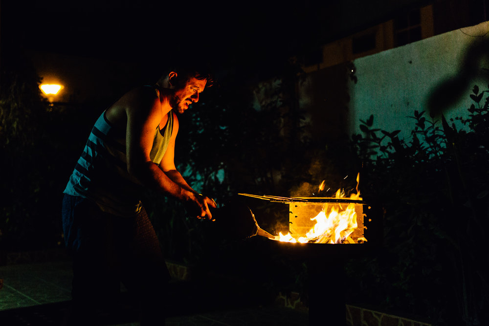 My friend Sasha would soon be leaving Oman. He invited me over for a barbecue at his house to say good bye. He's one of those guys who tells it like it is, stands up for what he believes in, and never gives up. His determined, but good-humored effort to get the coals started reminded me of his personality.