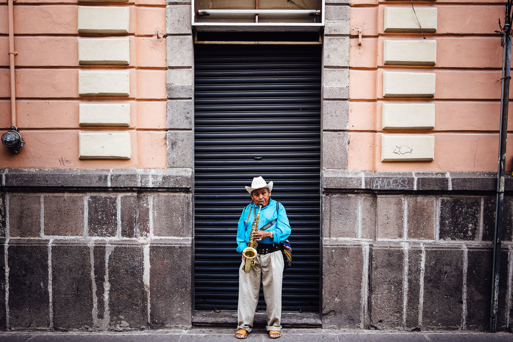 Sometimes I have to photograph something just because. This blind man was standing right in this doorway, between two stone and pink walls, playing the saxophone for passers by. He didn't have a collection plate or a hat out on the ground, and didn't seem to be expecting any money. He just played, swaying back and forth, and I thought it was beautiful.