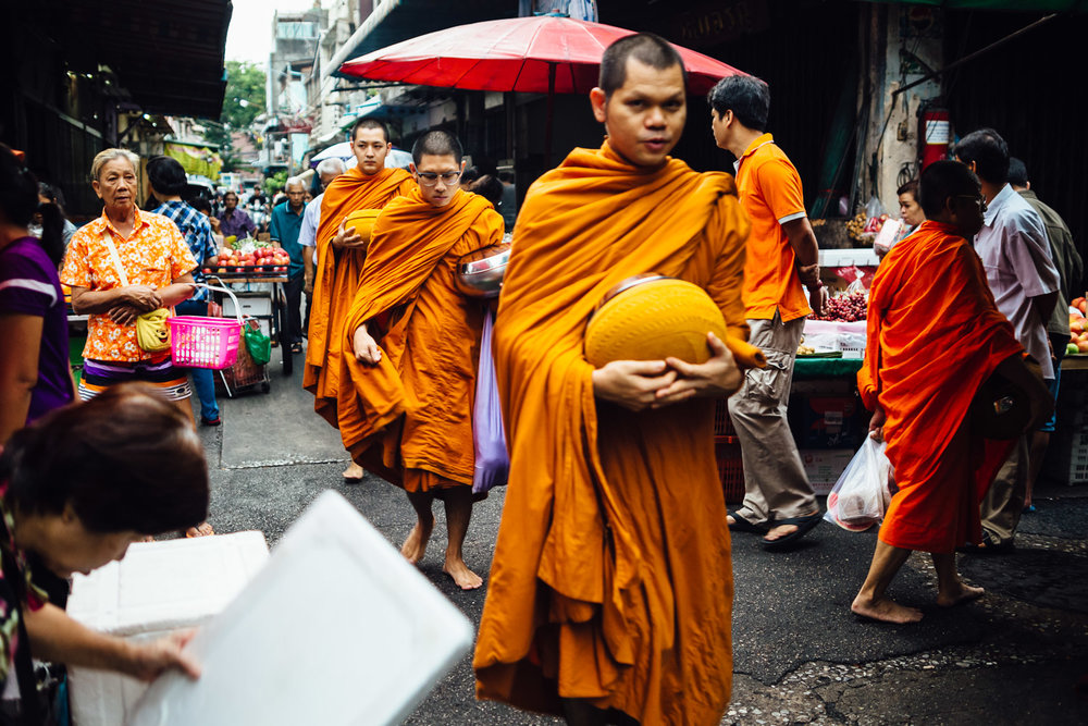 Monks-Three-Walking-Market-Looking-Orange-Robes-Travel-Thailand-Daniel-Durazo-Photography