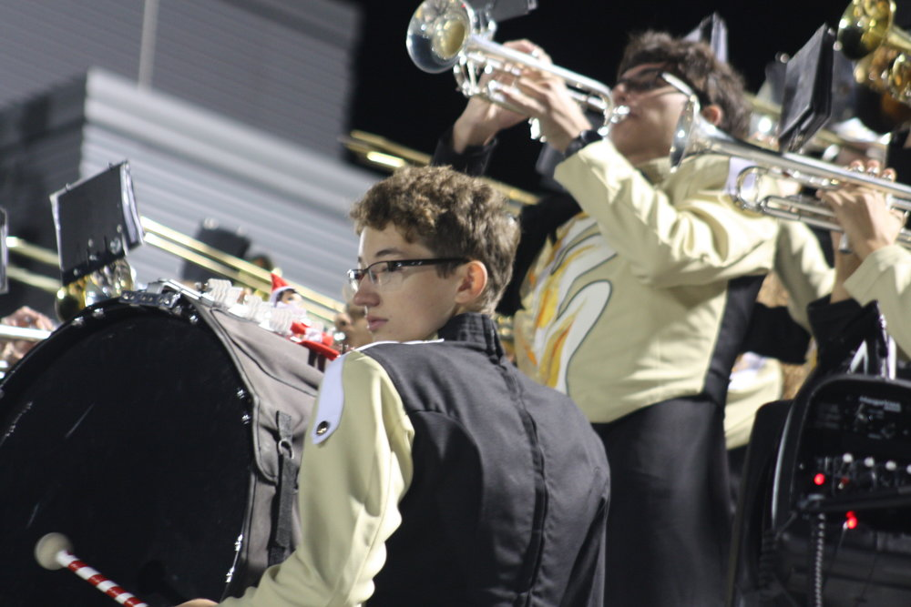 Cody in front on bass drum, Bailey behind on trumpet