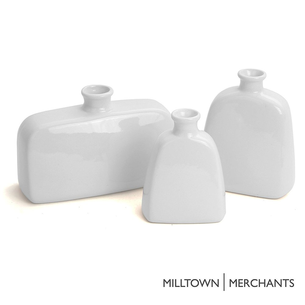 3 white ceramic vases.jpg