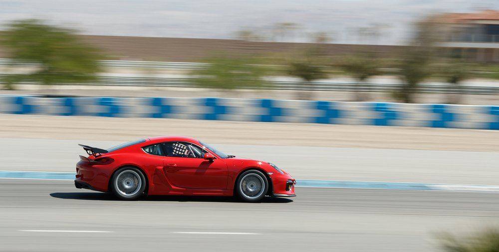 Porsche driving on a track