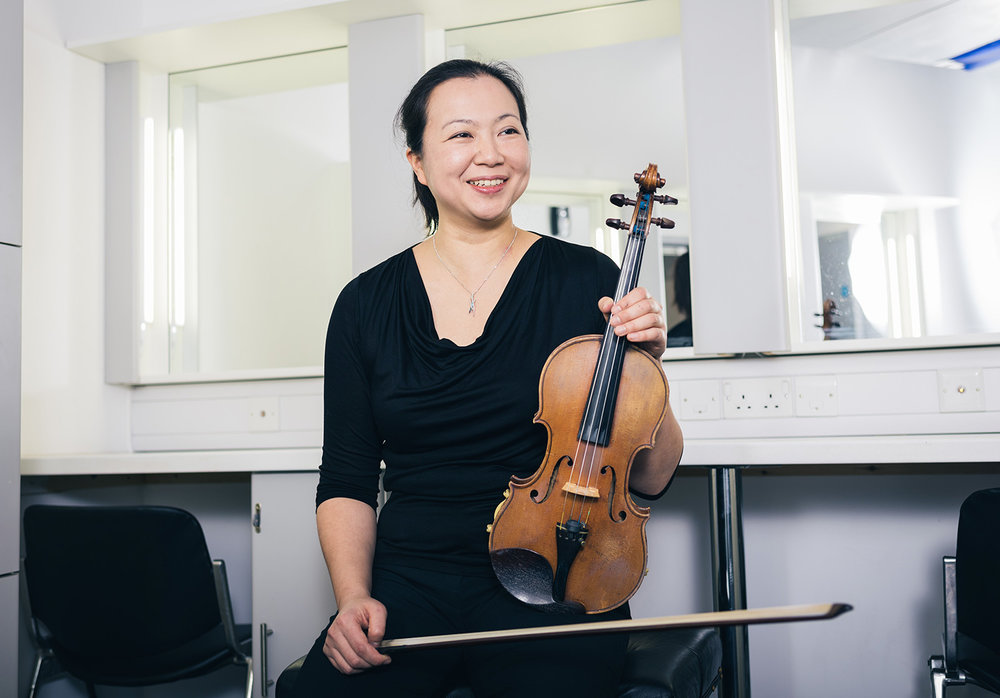 Noriko Tsuzaki, Director   Noriko's undergraduate studies took place at the University of Manchester where she studied the violin with Leland Chen and gained her MusB (Hons). She continued her studies at the Royal Northern College of Music studying violin with Thomas Kemp and achieving a Postgraduate Diploma in Performance and an MPhil in Performance. Noriko is passionate about teaching and currently teaches violin and piano at schools including Tudor Hall, Sibford and The Elms. She is also a tutor for the English Symphony Orchestra Children's Orchestras which she helps organise the courses and coaches young musicians aged six to eighteen on courses during school holidays. Noriko plays with various orchestras around the country and is a member of the Darwin Ensemble Chamber Orchestra and the English Symphony Orchestra.