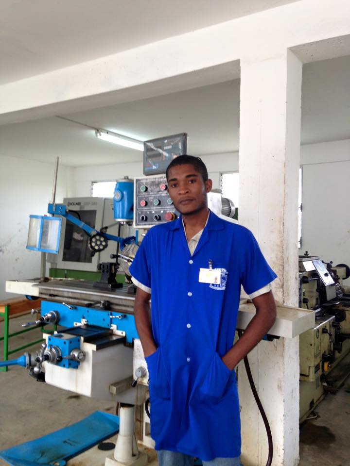 A recent graduate of Help the youth works is employed at a local factory