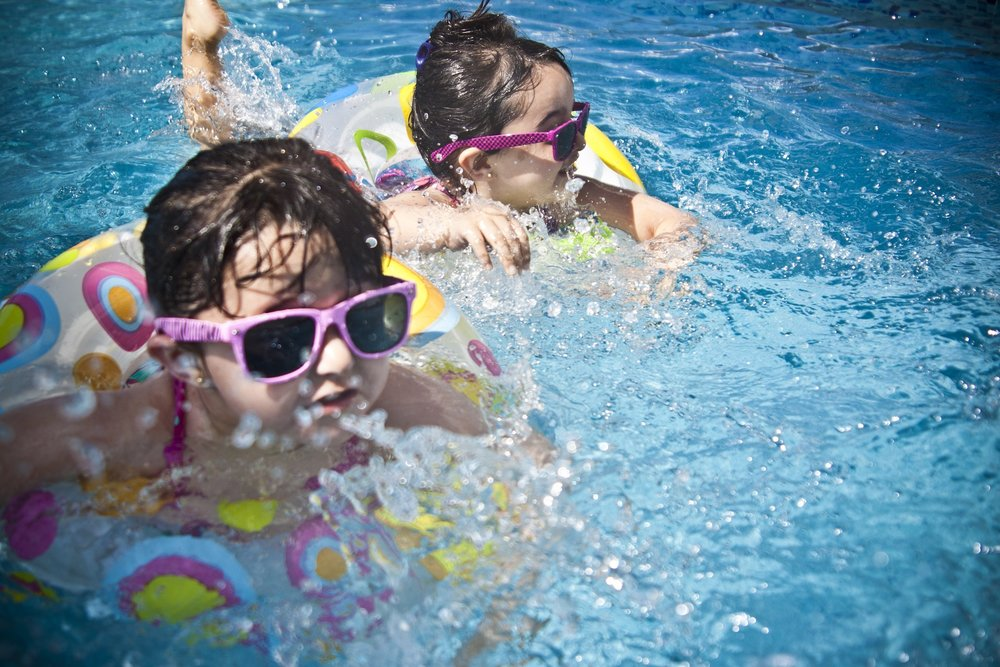 Kids Swimming with Sunglasses
