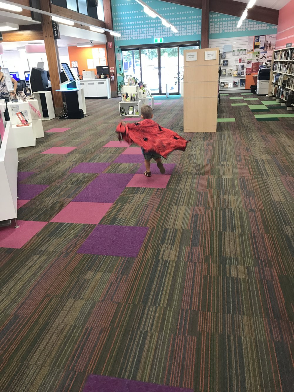 Dress up as superheroes and listen to stories at the library with the minis!