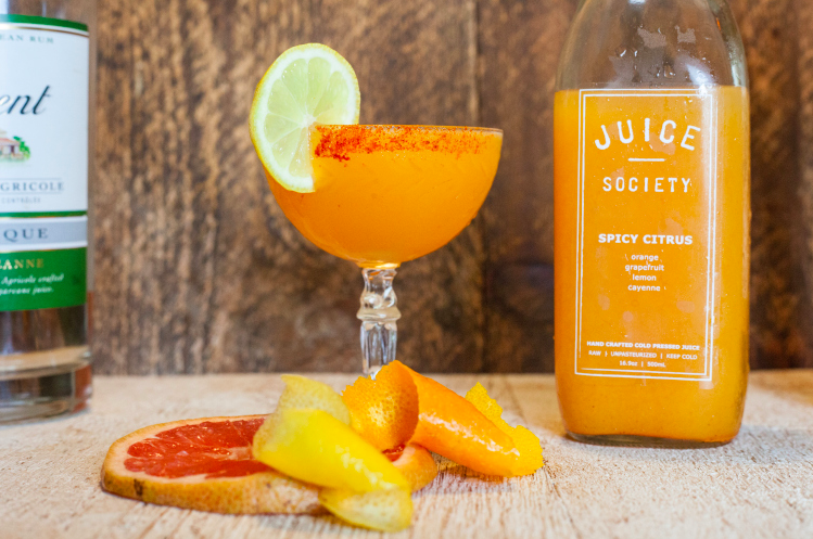 Juicy Ancho 3 ounces of Juice Society Spicy Citrus ½ ounce of Clement Premier Canne 1 ounce of Ancho Reyes Start your morning with a spiced up citrus cocktail. Rim half of the glass with cayenne pepper and serve with a lemon wheel.