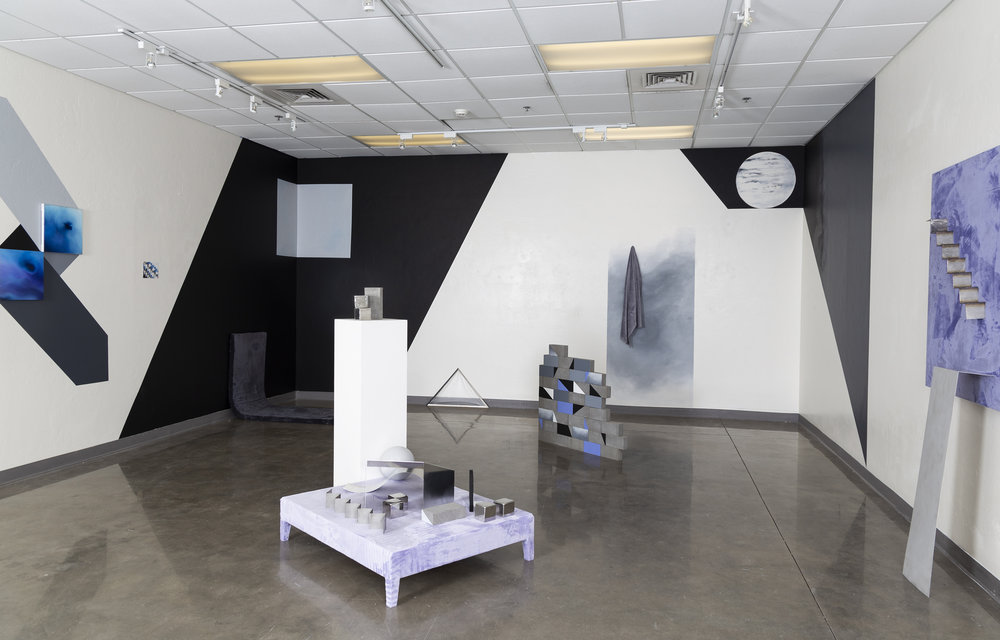 the Backdrop,  an installation exhibited at the University of Arizona Graduate and Alumni Gallery in January 2019, offers a surreal space composed of interior and exterior elements, drawing participants' attention to the various ways elements can be organized in a given space to achieve a sense of balance. Here, the colors, textures, materials, and shapes are chosen in response to the question: what is a backdrop? In other words, what is behind everything else, or what is the furthest thing we can perceive? Both breaking down the meaning of the word as well as how a backdrop functions in space, both in interiors and exteriors, I began to expand on these questions. What is consistently, inevitably behind everything else? How does the presence of the background inform the foreground? During the monsoon season this year, I began to tally all the materials and patterns around me on my daily walks with my dog. Looming shadows, brickwork, and the mutability of cloud formations became striking markers of dimensionality. Inside, these things are layered and framed within windows and doorways. Both cloudy textures and architectural shapes come together in two and three dimensions. In this work, false dimensions and shadows create a sense of movement within the space, taking elements often thought of as static and playing with them.
