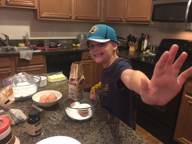 Brock making cookies by himself for the first time. Not sure how the Heisman pose relates...