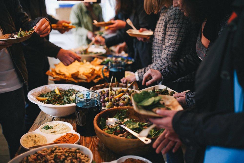 foodiesfeed.com_people-feasting-on-healthy-salad-buffet.jpg