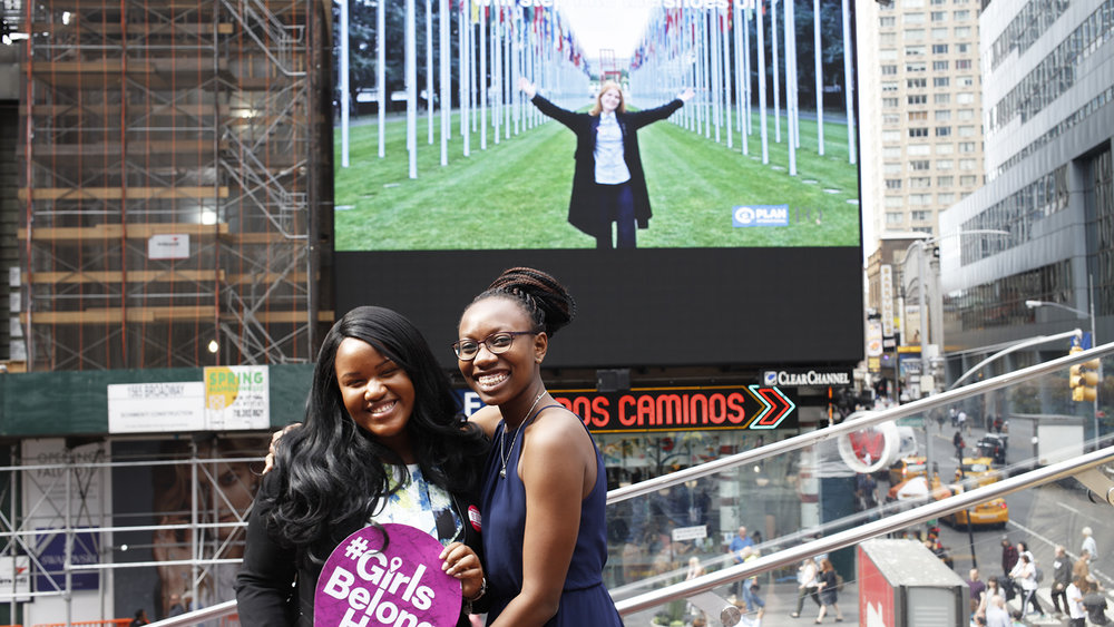 Plan USA Youth Advisory Board Members Johnnie and Mailka in Times Square.