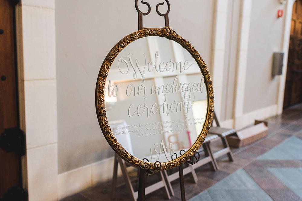 Sweet + Crafty | Mirror hand lettered unplugged ceremony sign #sweetandcrafty #wedding #weddingceremony #ceremonysignage #handlettering #calligraphy #weddingceremonysignage #romantic #elegant #luxurywedding #unpluggedwedding #customdesign #mirror #mirrorsignage #mirrorsign #calarealwedding #livermorevalley #weddingsignage