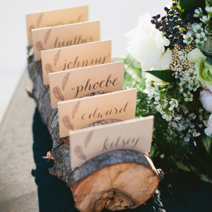 Sweet + Crafty | Wedding Kraft Paper Calligraphy Escort Cards with Boho Feather Design