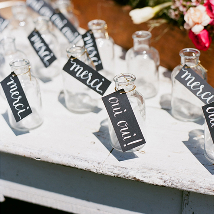 Sweet + Crafty | First Birthday Party Bud Vase Favors with Calligraphy Tags and Watering Can Calligraphy Sign