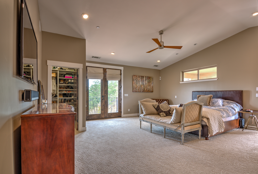 Huge master bedroom, vaulted ceilings, state of the art electronics, with his and her walk-in closets, 5 star bathroom, access to large private patio with lounge furniture, and french doors with a small overlook patio.