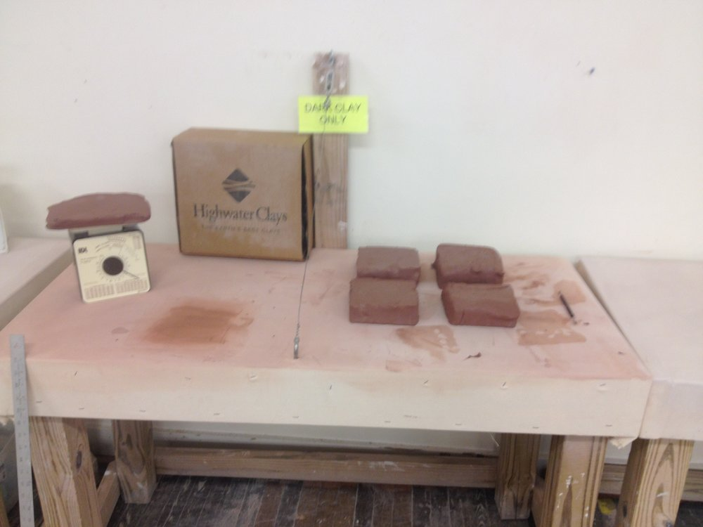The laborious process of manufacturing handcrafted tiles begins with cutting 25lb blocks of clay into 5lb blocks.