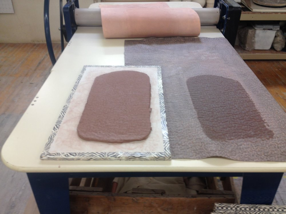 The clay slab is then transferred to a ware board which keeps the slab flat.