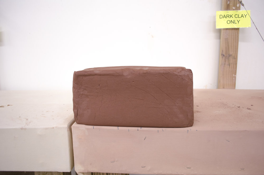 The tile process begins with a 25lb block of clay cut into 5lb blocks