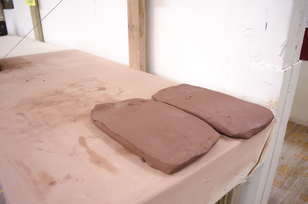 The clay is then stretched using manual techniques to flatten the clay