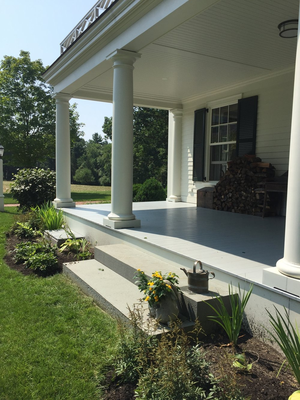 The side porch is just off of the parking area and serves as the main entrance for family - Photo: Linda Davis