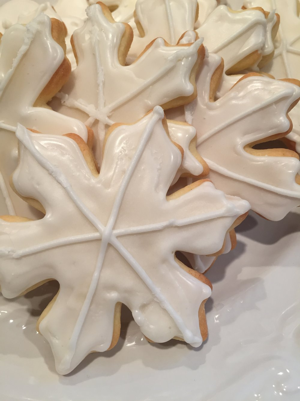 Snowflake sugar cookies... note the piping on the top is not smooth. This is what happens if you are too anxious to put them on a plate and the icing is not completely dry. This year I will make sure to let them sit longer.