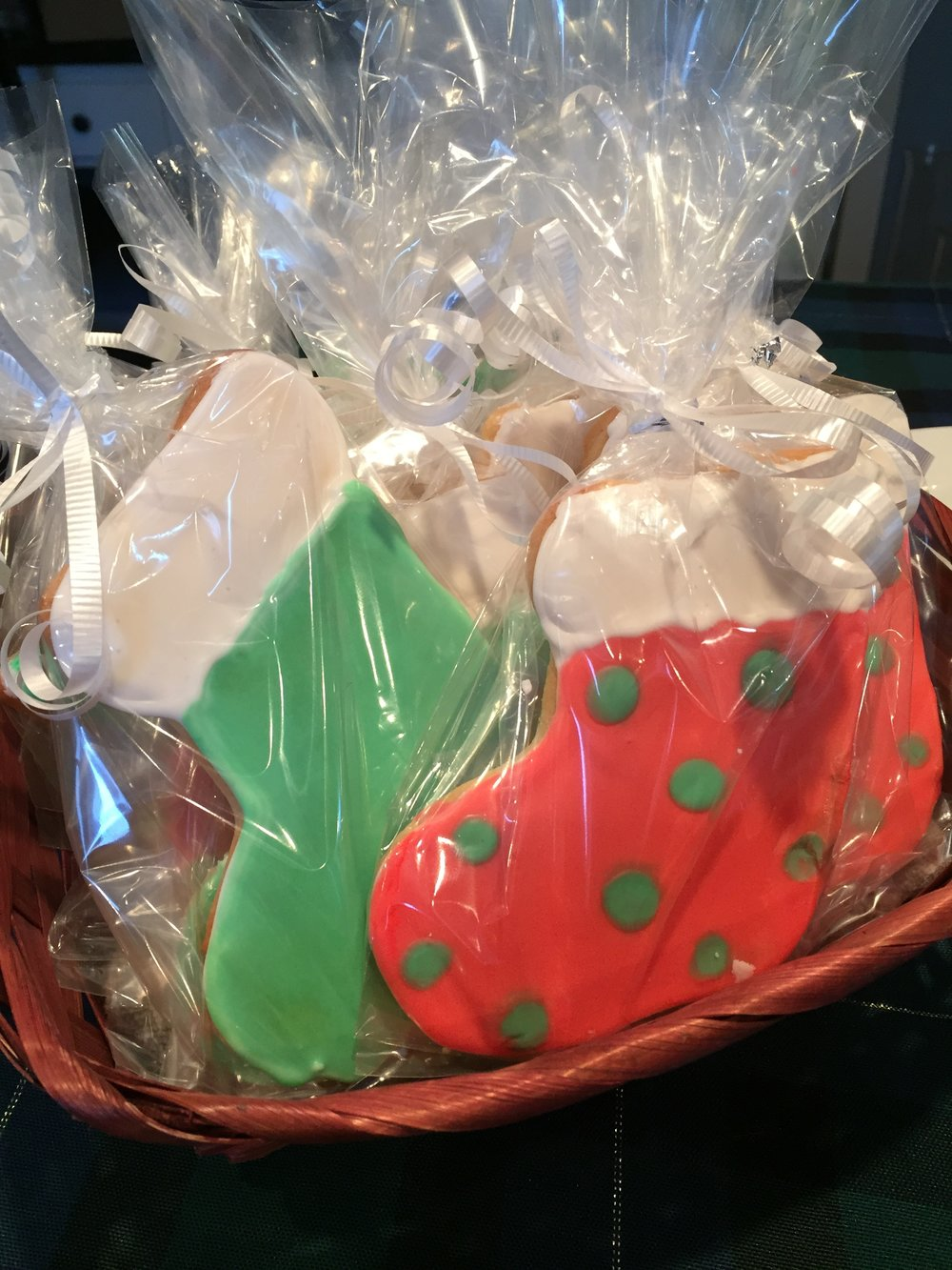 These cookies were wrapped as gifts and put in gift bags with other treats such as my sugar pecans. Other cookies were used as place settings. I piped names across the top of the stocking so that guest would know where to sit during dinner, then they had a little gift to take home or eat as part of their dessert.